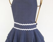 Diva Apron  - Navy with White polka dots with rick rack trim.