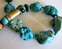 large HEAVY turquoise magnesite nuggets with cast bronze tube