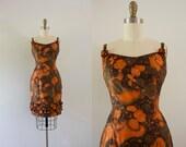 S A L E . . 1960s Golden Bombai floral bombshell wiggle dress / 60s safari rose