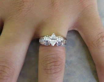 14k white gold marquise and baguette diamonds engagement ring.
