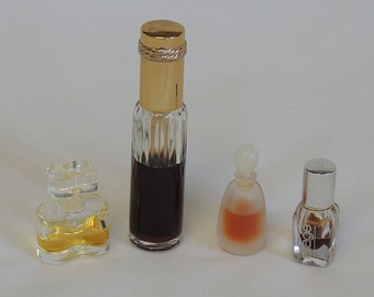 4 Vintage ESTEE LAUDER Perfume Bottles.. Private Collection, Aliage, White Linen & Youth Dew