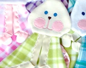 Replica bunny puppet blanket in bright green plaid with white satin trim