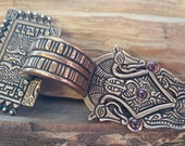 Scandinavian Square-headed bow brooch with silver accents- bronze, garnets