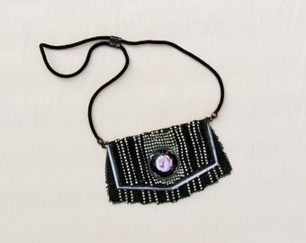 C.1930 Whiting and Davis enameled mesh purse with enamel rose medallion, black and white mesh evening purse with silver plated frame