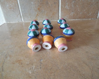 Ceramic pull knobs pretty pastel colors  they look like cupcakes cute on a childs dresser. 1.99 EACH