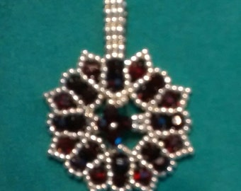 Pendant to glam up a necklace.