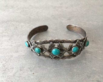 Vintage native American turquoise and silver arrow cuff