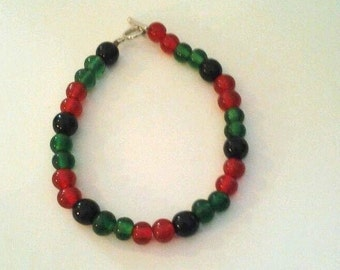 Multicolored beaded bracelet,  hand crafted, 7-1/2 inches, glass beads, red, green, black beads, gift for her