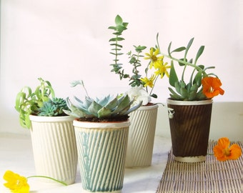 Ceramic planter for succulent pot plants. Also perfect as a cactus pot. Or a tea cup!