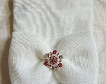 White Hospital Newborn Beanie with matching White Bow with added Sparkle! Pink and Clear Rhinestone Center. Baby Girl Hospital Hat