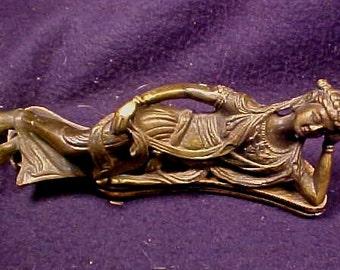 Bronze cast reclining figure
