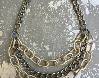 Mixed metal multistrand chain necklace.   18 inches long.