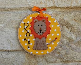 Embroidered lion hoop art: Felt lion, hand stitched on polka dot fabric