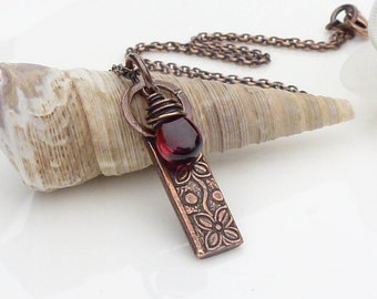 Copper and garnet necklace, textured patterned solid copper flower necklace pendant with dark red garnet gemstone, handmade copper jewelry
