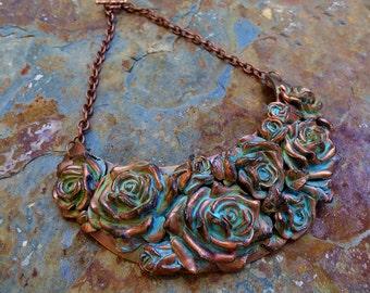 Distressed copper rose bouquet bib necklace