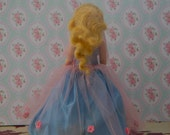 Meet Rapunzel: A Dazzling Vintage Golden-haired Doll