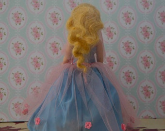Meet Rapunzel: A Dazzling Vintage Golden-haired Doll