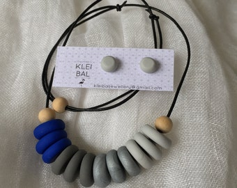 Blue, grey and silver beaded necklace with wooden accent beads.