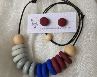 Blue, red, grey and silver beaded necklace with wooden accent beads.