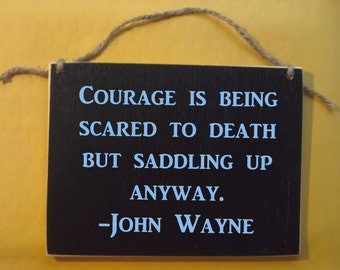"""Courage is being scared to death but saddling up anyway John Wayne saying. Funny Wood Sign Small 5x7"""" gift"""