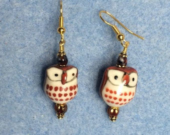 Dark orange ceramic owl bead earrings adorned with Czech glass beads.