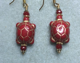 Red Czech glass turtle bead earrings adorned with Chinese crystal beads.