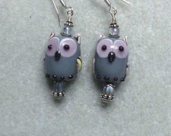 Grey lampwork owl bead earrings adorned with grey Czech glass beads.