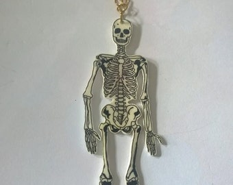 Hand drawn full skeleton shrink plastic necklace.