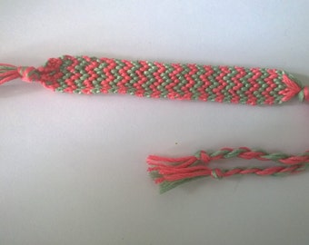 Pink and green zigzag friendship bracelet.