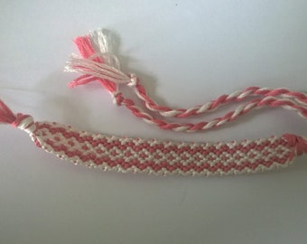 Pink and white square friendship bracelet.