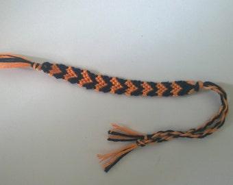 Black and orange heart friendship bracelet.
