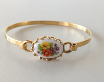 Golden bracelet with cameo in ceramic painting-Avon Cosmetics-vintage anni