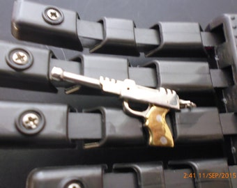 Raygun    sterling siver with brass grips