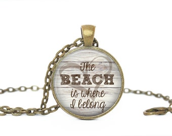 The beach is where I belong. Gift. Comes as a necklace or keychain.