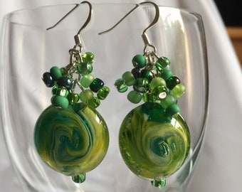 Green swirl drop earrings