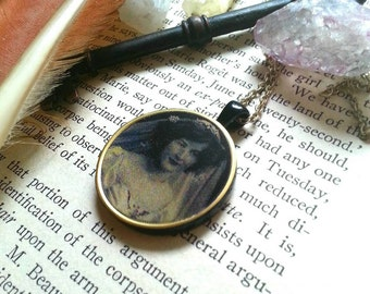 Haunted changing portrait necklace