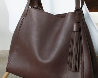 Shoulder bag in supple brown leather.  Leather hobo handbag with fringe.  Handmade in Belgium.  Back in stock in brown leather.