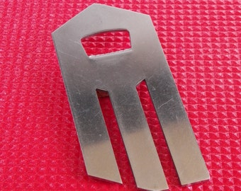Stainless steel bottle opener Facom industrial design French bar accessory brand advertising item Made in France