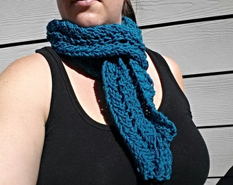 Blue hand knitted scarf.
