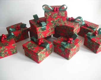 Beautiful handmade boxes, in a red holly fabric,  topped with green ribbon and embellished with holly berries. Ideal festive gift...
