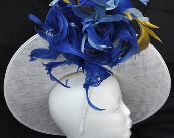 Surfs up! Royal Blue Hatinator, White Headpiece, Hat with a touch of yellow! Wedding, Ascot, Racing.Detailed stitching & lots of Feathers