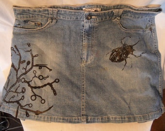 Denim skirt with tree and beetle