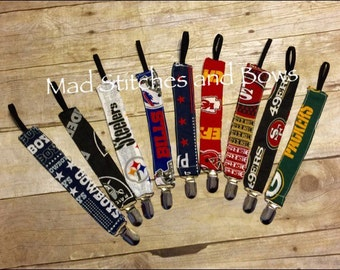 Football biky clip /Sports team Binky pacifier clip