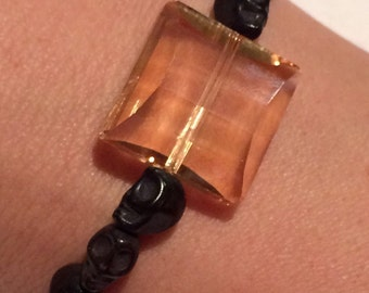 Black skulls w/ cream crystal beaded bracelet
