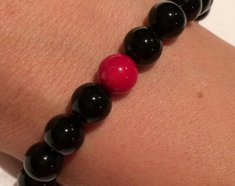 Black and bright red stone beaded bracelet