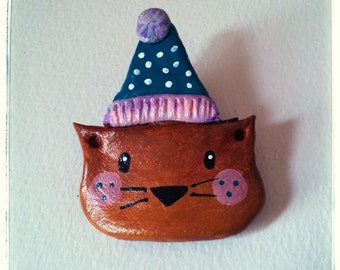 Lovely air-dry clay cat wearing it's hat brooch.