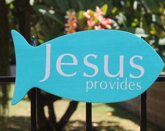 JESUS provides wood sign