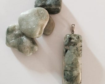 handcrafted resin pendant made with sage sand stones