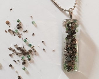 handcrafted resin pendant made with sprinkles of steampunk confetti