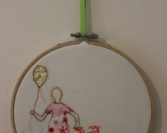 Girl with Balloon and Bicycle in an Embroidery Hoop